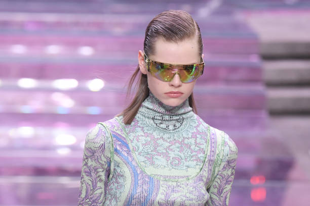 MILAN, ITALY - JUNE 15: A model, sunglasses details, walks the runway at the Versace fashion show during the Milan Men's Fashion Week Spring/Summer 2020 on June 15, 2019 in Milan, Italy. (Photo by Victor Boyko/Getty Images)