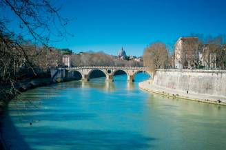 a bridge over the river tiber in rome with clear blue sky, rome, latium, italy, march 12, 2019