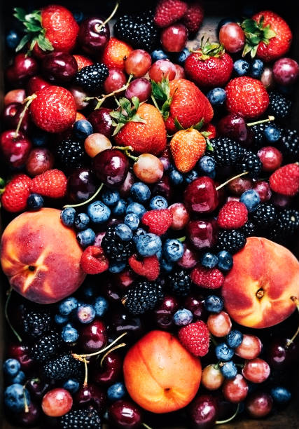 Background of fresh fruits (carry, berries, peaches)