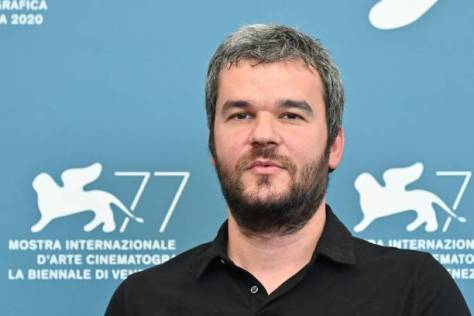 "Greek director Christos Nikou attends a photocall for the film ""Mila"" (Apples) presented in the Orizzonti competition on the opening day of the 77th Venice Film Festival, on September 2, 2020 at Venice Lido during the COVID-19 infection, caused by the novel coronavirus. (Photo by Alberto PIZZOLI / AFP) (Photo by ALBERTO PIZZOLI/AFP via Getty Images)"
