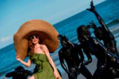 """Dutch actress Lotte Verbeek and the cast of """"The Book Of Vision"""" recreate a scene from the movie during the 77th Venice Film Festival on September 3, 2020 on a beach at Venice Lido, during the COVID-19 infection, caused by the novel coronavirus. (Photo by Tiziana FABI / AFP) (Photo by TIZIANA FABI/AFP via Getty Images)"""