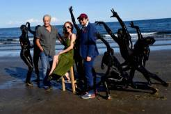 "(From L) English actor Charles Dance, Dutch actress Lotte Verbeek, Italian director Carlo Hintermann and the cast of""The Book Of Vision"" recreate a scene from the movie during the 77th Venice Film Festival on September 3, 2020 on a beach at Venice Lido, during the COVID-19 infection, caused by the novel coronavirus. (Photo by Tiziana FABI / AFP) (Photo by TIZIANA FABI/AFP via Getty Images)"