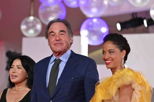 US director Oliver Stone, his wife Sun-jung Jung, (L) and guest arrive to attend the Kineo Prize Ceremony on the fourth day of the 77th Venice Film Festival, on September 5, 2020 at Venice Lido, during the COVID-19 infection, caused by the novel coronavirus. (Photo by Alberto PIZZOLI / AFP) (Photo by ALBERTO PIZZOLI/AFP via Getty Images)