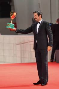 VENICE, ITALY - SEPTEMBER 12: Pierfrancesco Favino poses with the Coppa Volpi for Best Actor during the winners photocall at the 77th Venice Film Festival on September 12, 2020 in Venice, Italy. (Photo by Stephane Cardinale - Corbis/Corbis via Getty Images)