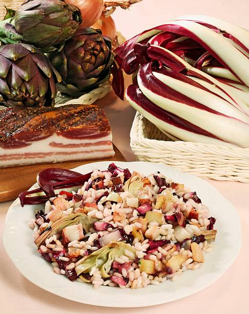 UNSPECIFIED - JANUARY 27: Risotto with radicchio (chicory) and artichokes. (Photo by DeAgostini/Getty Images)
