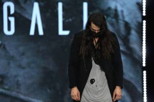 """ROME, ITALY - FEBRUARY 20: Designer Justin Gall walks the runway at the Gall """"Nydia"""" Fashion Show during the Altaroma 2021 on February 20, 2021 in Rome, Italy. (Photo by Ernesto S. Ruscio/Getty Images)"""
