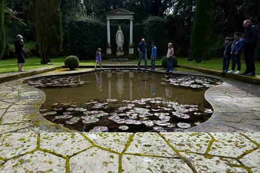"""People visit the Madonna garden, part of the gardens of Pope's summer residence of Castel Gandolfo, south of Rome, on March 22, 2014 in Castel Gandolfo. From March 1st, the gardens surrounding the papal summer residence are open to the public. Located south of Rome in the Alban hills, the property includes the extensive Barberini gardens, the remains of a Roman villa and a 62 acre farm, as well as the ancient papal palace. A statement from the director of the Vatican Museums says it was Pope Francis himself who decided to make accessible to all the gardens of the Pontifical Villas. A guided tour of the gardens, in Italian or English, will be available to individuals or groups through an online booking system. AFP PHOTO / VINCENZO PINTO = RESTRICTED TO EDITORIAL USE - MANDATORY CREDIT """"AFP PHOTO/VINCENZO PINTO"""" - NO MARKETING NO ADVERTISING CAMPAIGNS - DISTRIBUTED AS A SERVICE TO CLIENTS = (Photo credit should read VINCENZO PINTO/AFP via Getty Images)"""