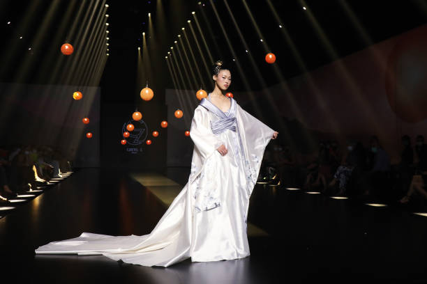"""ROME, ITALY - JULY 10: A model walks the runway at the Gretel Z. """"Come Un'Estate A Kyoto"""" fashion show during Altaroma 2021 at Cinecitta Studios on July 10, 2021 in Rome, Italy. (Photo by Elisabetta Villa/Getty Images)"""
