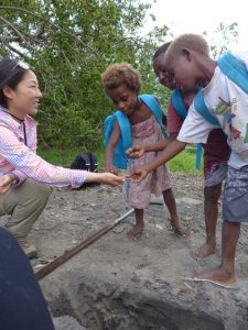 Showing school children sediment from a soil pit on Tanna at Port Resolution Bay. Credit: Isabel Hong.