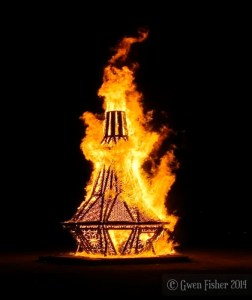 The Genie Bottle goes up in flames at Burning Man. Image copyright Gwen Fisher. Used with permission.