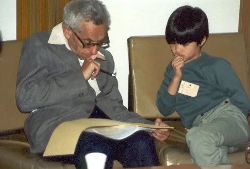 A 10 year old Terrence Tao hard at work with Paul Erdos in 1985. Couresty of Wikimedia Commons.