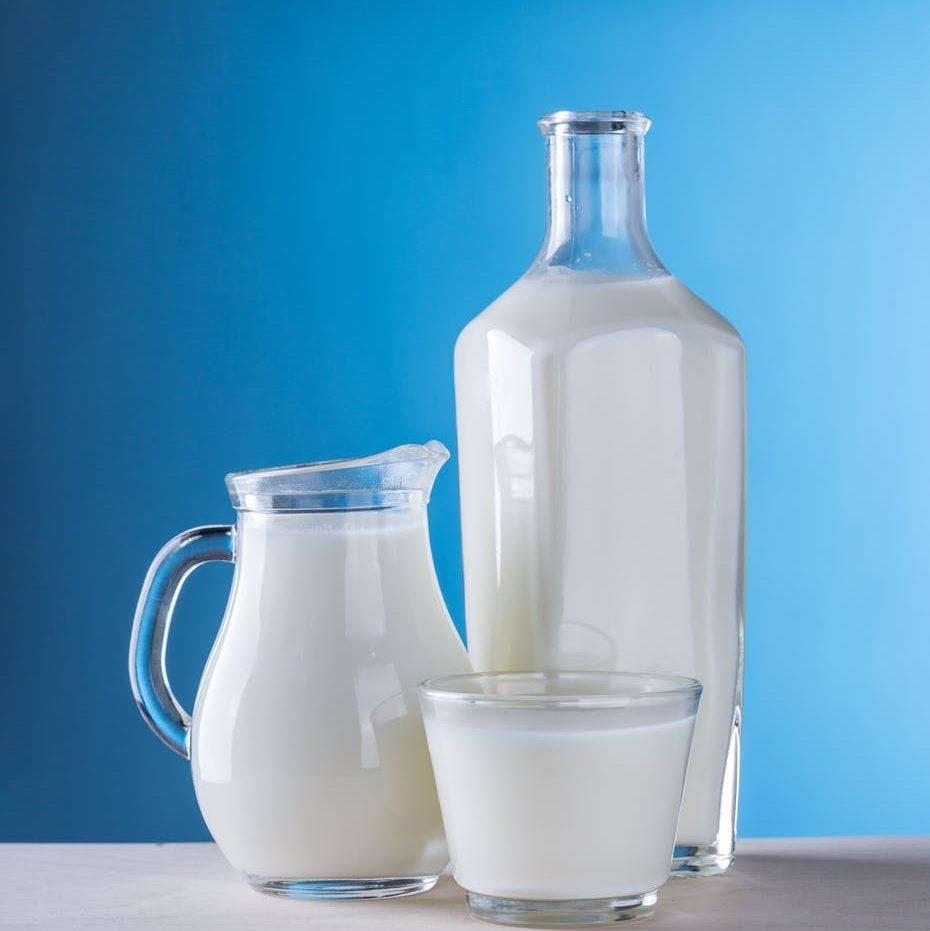 close up of milk against blue background