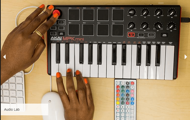 a picture of a woman's hands manipulating a Mini mixing board
