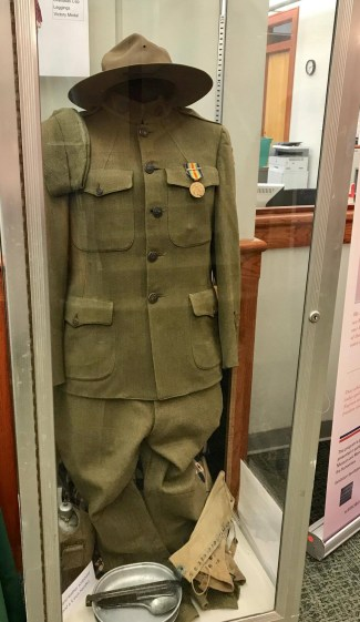 Display case featuring a WW1 uniform and hat.