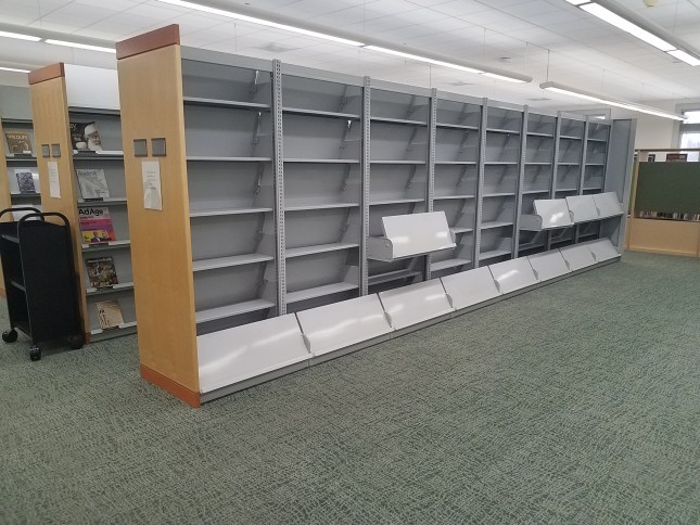 Photo of empty, disassembled shelving units