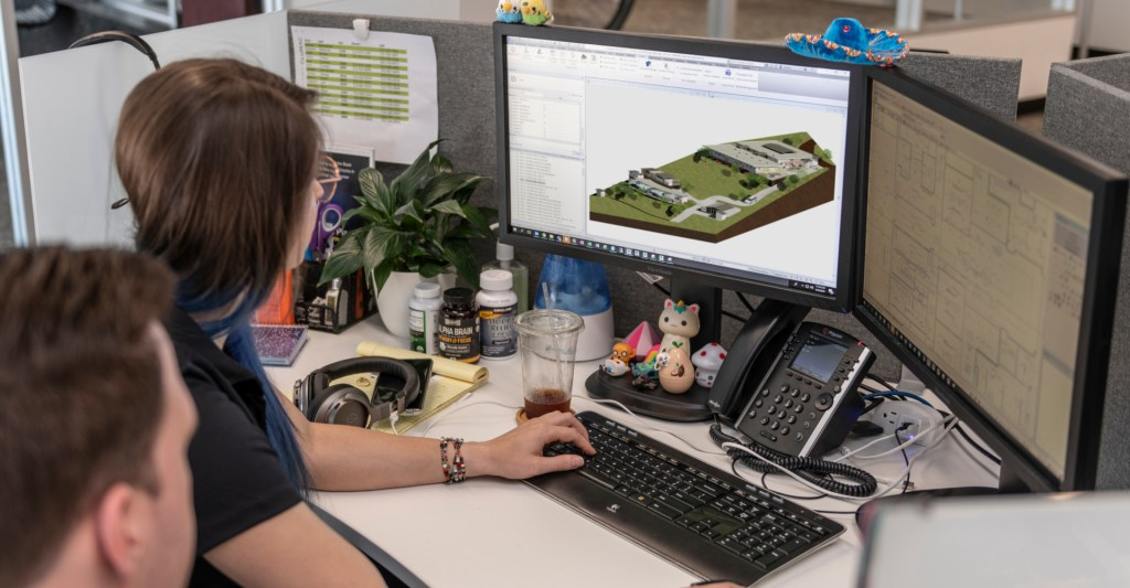 Person reviews site plan and design