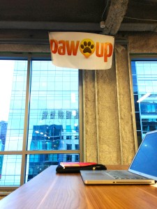PawUp's sign at the MassChallenge in the innovation district