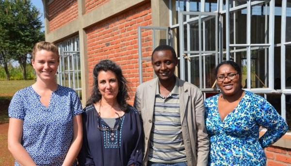 Dr. Askwar Hilonga of Karatu, and Babson College staff: Michelle McCormack, Sarah Schwartz, Janai Mungalsingh outside Michela's Room, Ganako Secondary School. Photo: Sharon yardley