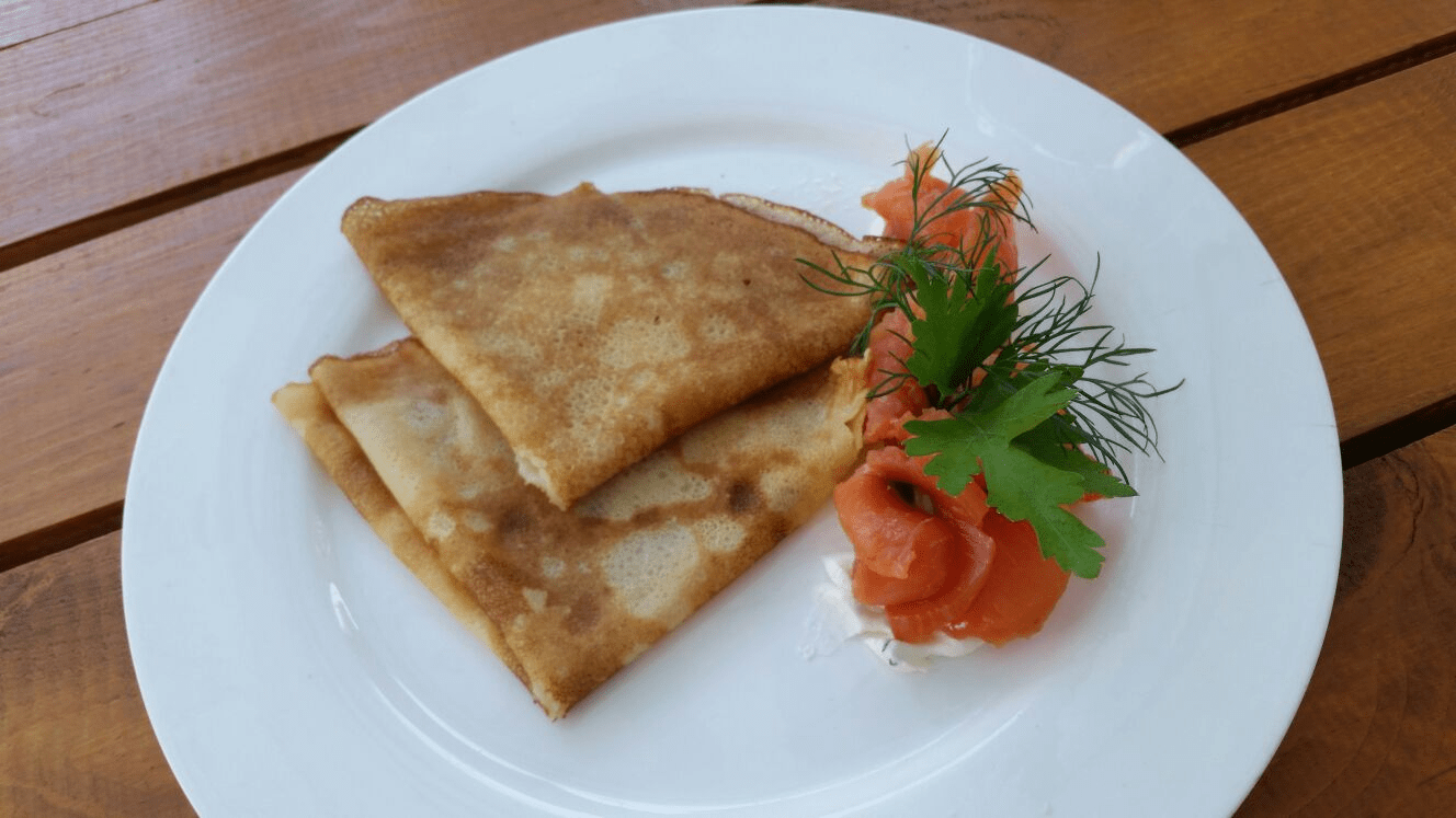 These traditional Russian pancakes, called bliny, are made from buckwheat flour--come topped with goodies ranging from butter and sour cream to pickled fish and caviar.