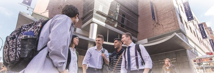 Students outside of the newman vertical campus