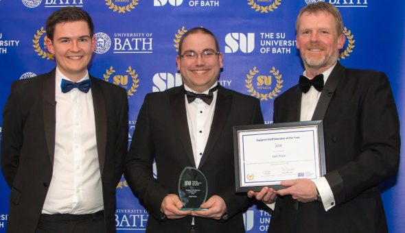 Neil Price is awarded with Support Staff Member of the Year award by Professor Peter Lambert and Jack Kitchen