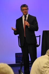 image of dr. frank lewis addressing an audience