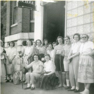 Members of the Beta Sigma Alpha sorority prepare for a hiking trip outside of crowded Boston in 1957.