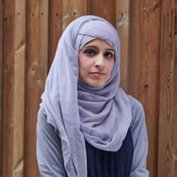 Headshot of Amreen.