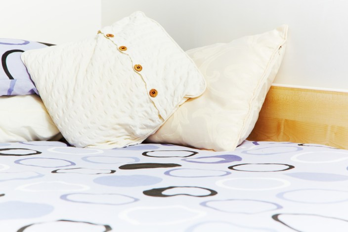A closeup shot of some bedding in a student accommodation room.