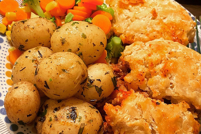 One of Aimee's cooked meals, including carrots and baby potatoes.