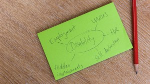 Pencil and notepad with text reading disability, employment, unions, HR, self declaration and hidden impairments