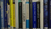 Books about Europe on shelf.