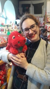 Camille Rey holding a toy red dragon