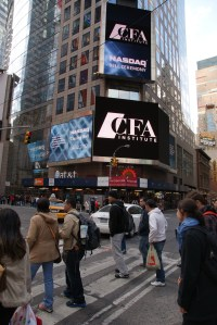 NASDAQ sign on 3 Times Square (Thomson Reuters Building) highlights CFA Institute at NASDAQ bell ceremony.