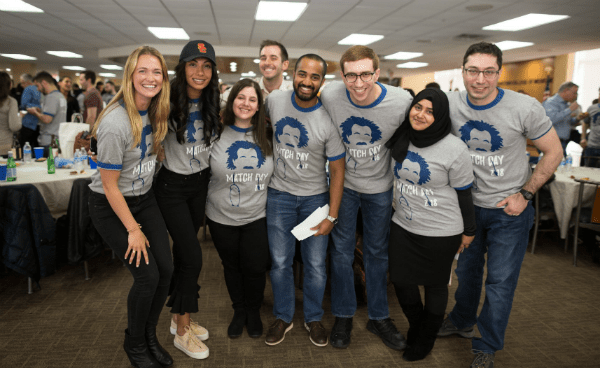 Several students happily posing together at Match Day 2018 - Albert Einstein College of Medicine