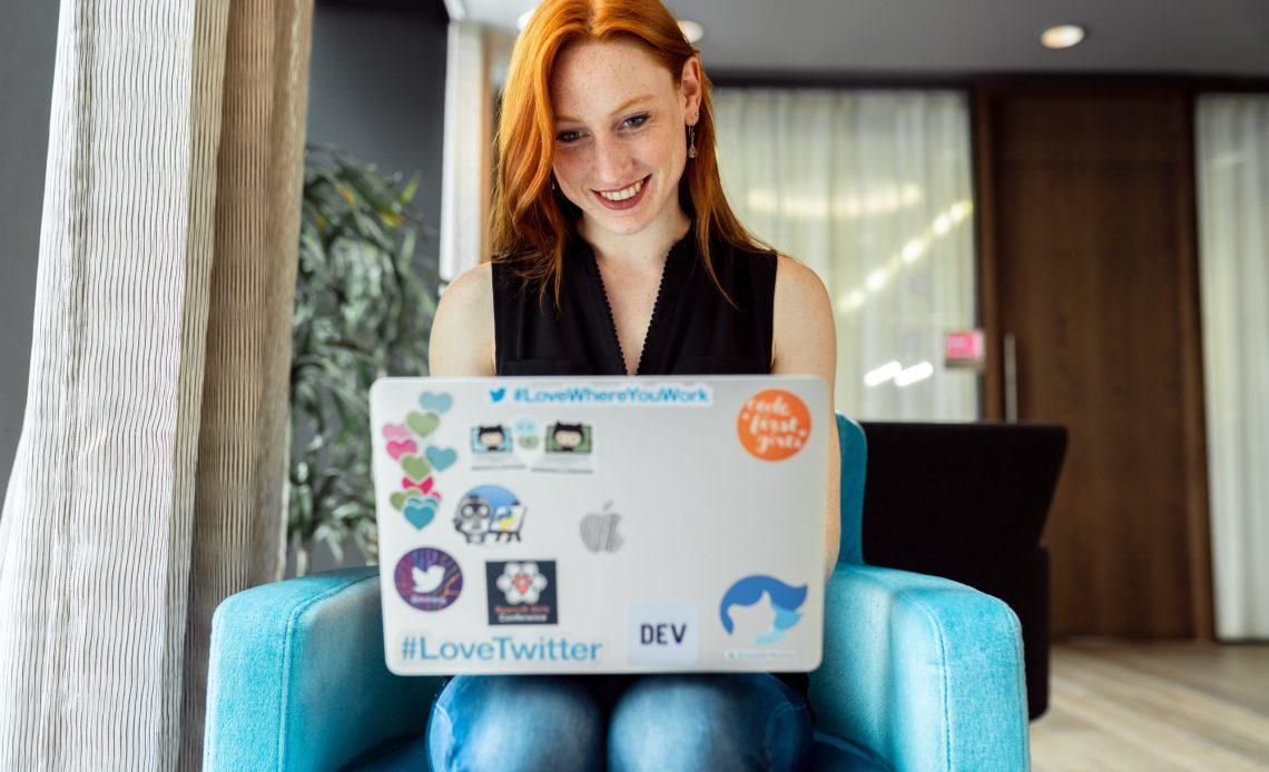 Smiling websockets webrtc developer with laptop