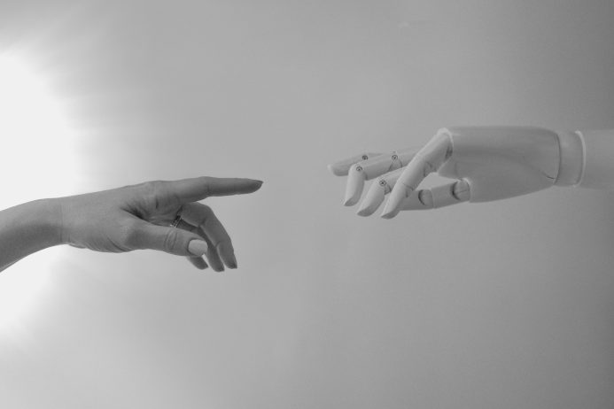 The inexorable rise of the supercharged developer - ai touching hands with a human