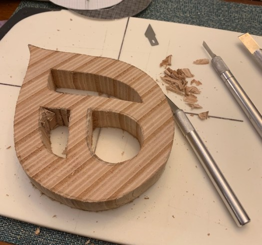 Cutting and chiseling the design.