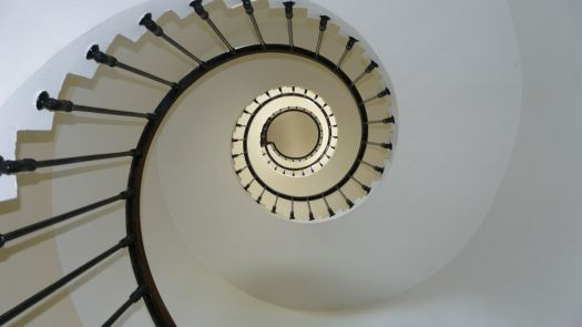 A spiral staircase can be seen.