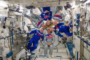 Expedition 37 crew members pose for a photo in Kibo. Credits: NASA