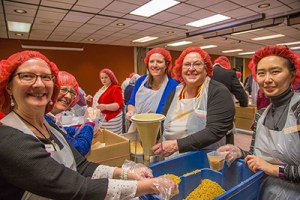 packaging meal kits for Meals from the Heartland during annual conference 2018.