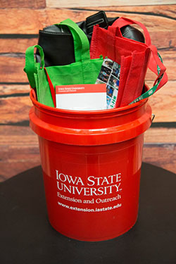 red bucket filled with merchandise