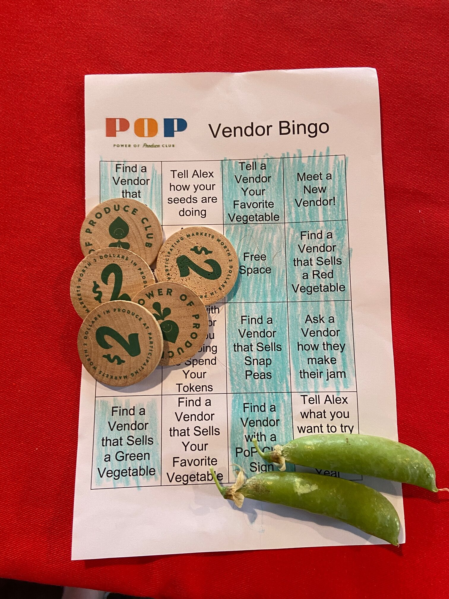 Completed Bingo card with tokens and peas