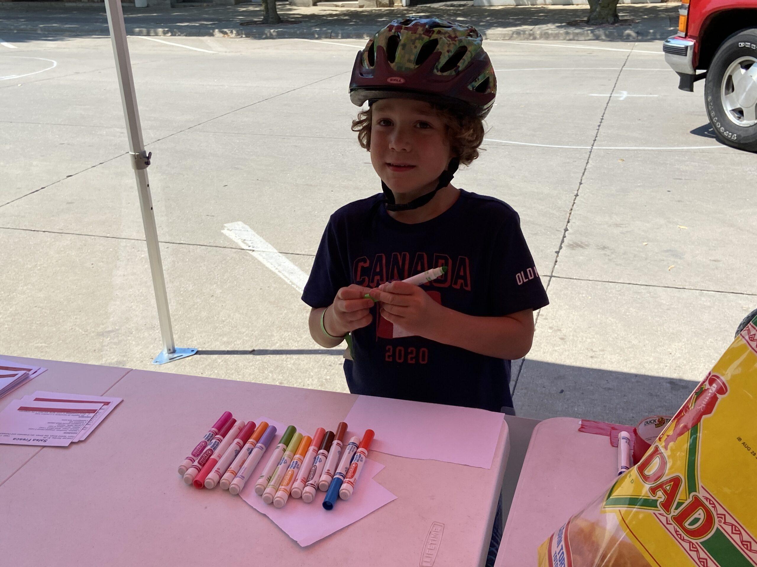 boy holding a marker