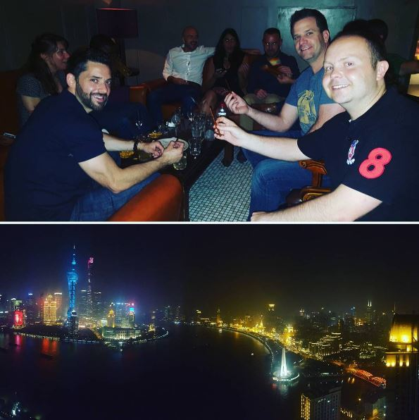 classmates toasting and a nighttime view of the river in Shanghai, during a day in the life of a Global Executive MBA student