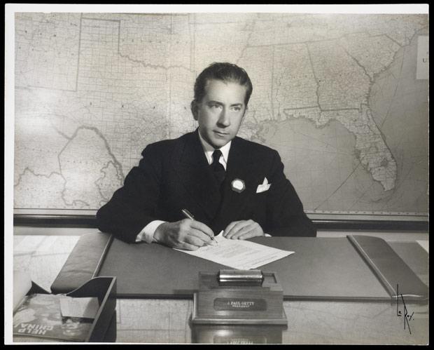Portrait of J. Paul Getty at his desk