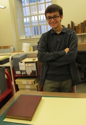 Cambridge Rindge and Latin student, Jaret Berman, helps create a custom folder for a scrapbook.