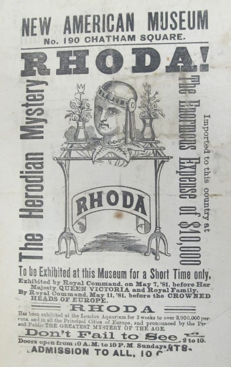 "A poster advertising a sensational exhibition called ""Rhoda, The Herodian Mystery,"" a disembodied, living head."