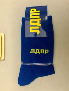 A pair of socks with the Liberal-Democratic party logo