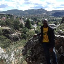 Me posing in front of a mountain view of Cercedilla, a town outside of Madrid.